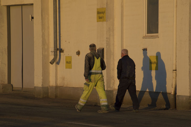 Aarhus, Denmark Architecture Building Exterior Built Structure Day Full Length Men Occupation Outdoors People Protection Protective Workwear Real People Reflective Clothing Standing Sunrise Shadows Two People Uniform