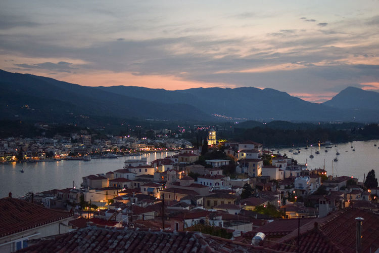 Panoramic view of Poros town Greek Islands Lights Architecture Built Structure City Cityscape Cloud - Sky Greece High Angle View Island Mountain Mountain Range Mountains Nature Outdoors Sailing Sea Sky Sunset Tourism Town TOWNSCAPE Travel Destinations Wallpaper Water