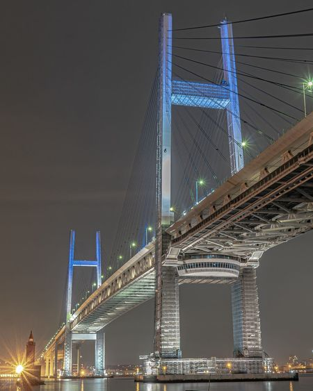 Low angle view of illuminated suspension bridge