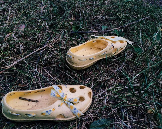 High angle view of shoes on grass