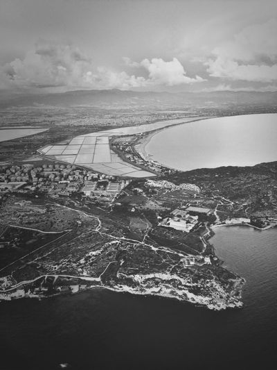 Aerial view of bay against sky
