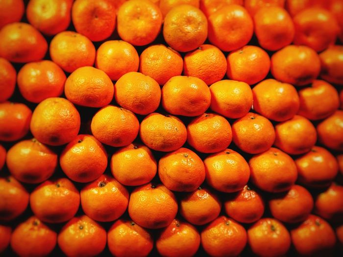 Full frame shot of oranges for sale at market stall
