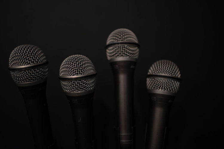 how many mics Arts Culture And Entertainment Black Background Close-up Communication Focus On Foreground Group Of Objects Indoors  Input Device Metal Microphone Music No People Pattern Performance Side By Side Silver Colored Sound Recording Equipment Still Life Studio Shot Technology Three Objects