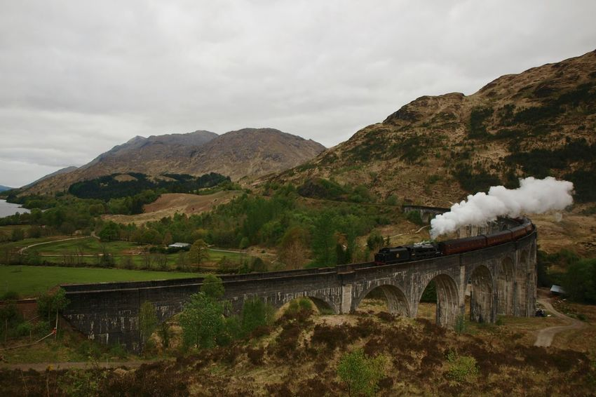 Glenfinnan Viaduct Loch Shiel Famous Place Railway Architecture Transportation Highlands Scotland Hills Sky Railroad Mountain Landscape Bridge Harry Potter Hogwarts Express Outdoors Beauty In Nature Steam Train Locomotive Steam Railway Bridge Arch Stone Track
