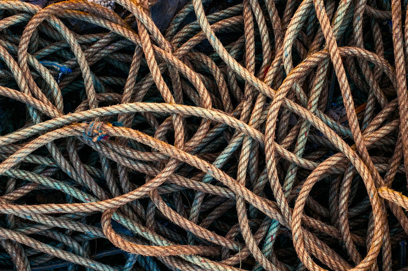 pile of rope Rope Stack Braided Braiding Close-up Cord Day Full Frame Heap Knit Navigation No People Pattern Pile Of Rope Rope Rope Art Thick