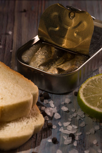 Bread Can Close-up Day Focus On Foreground Freshness Indulgence No People Part Of Pepper Ready-to-eat Sald  Sardines Selective Focus Still Life Temptation Toast Wood