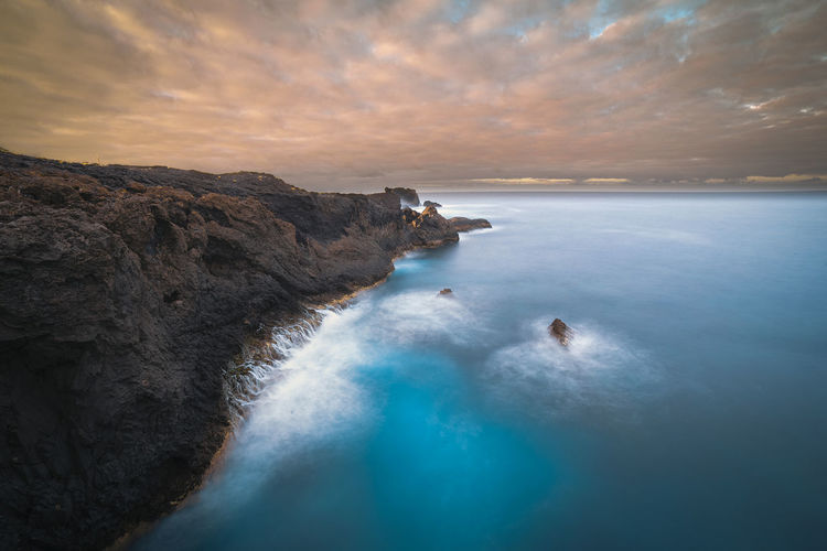 Water Landscape Seascape Cloud - Sky Sunset Sun Sea Rocks Beauty In Nature Scenics - Nature Rock Rock - Object Sky Tranquil Scene Nature Tranquility Solid Land Idyllic Horizon Over Water Long Exposure No People Horizon Outdoors Lagoon