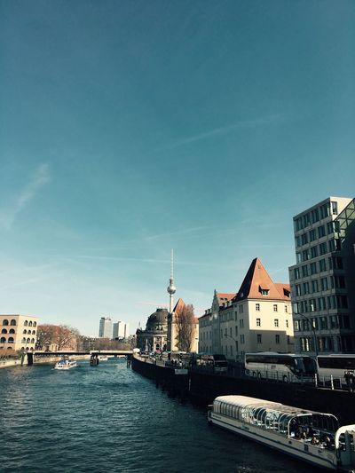Spree river in city against sky