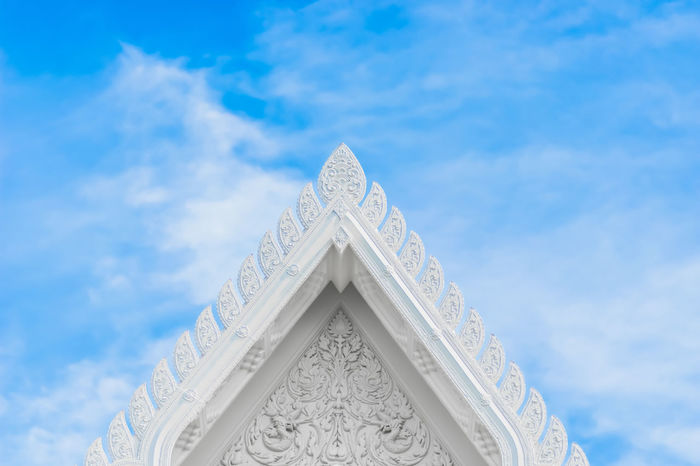 Close up of white old thai temple roof with window and beautiful blue sky. ASIA Famous Historical Building Roof Rooftop Thai Tradition Wall Architecture Art Arts Culture And Entertainment Blue Building Exterior Built Structure Close-up Cloud - Sky Cultures Day History Low Angle View No People Outdoors Sky Temple White