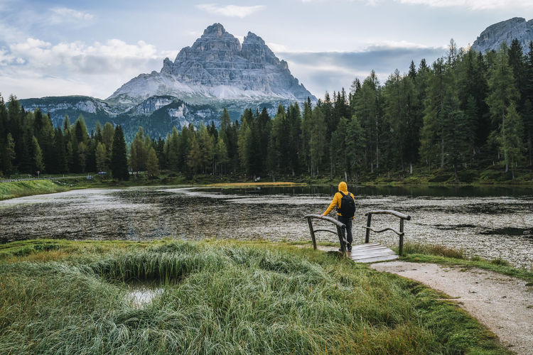 Man standing by plants against mountains