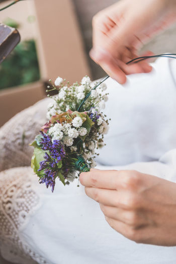 Flower Wreath Human Hand Hand Real People Holding Flower Human Body Part One Person Flowering Plant Plant Lifestyles Women Freshness Midsection Bouquet Selective Focus Adult Flower Arrangement Nature Vulnerability  Finger Bunch Of Flowers