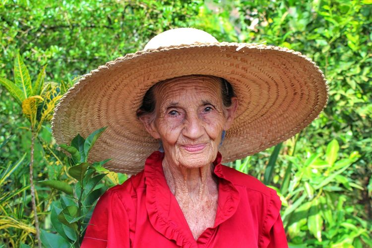Hat Only Women Portrait Smiling One Woman Only Looking At Camera Outdoors Happiness Sun Hat Adult Agriculture Adults Only Nature Day Headshot Women Mature Adult One Senior Woman Only One Person Farmer