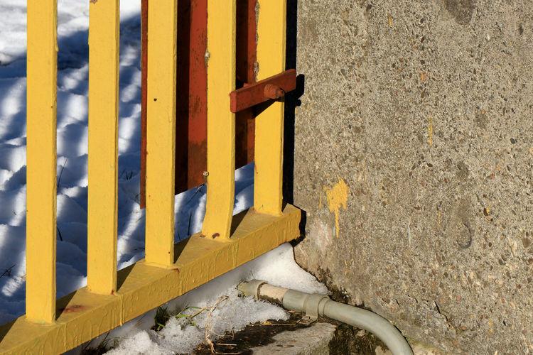 High angle view of yellow wall