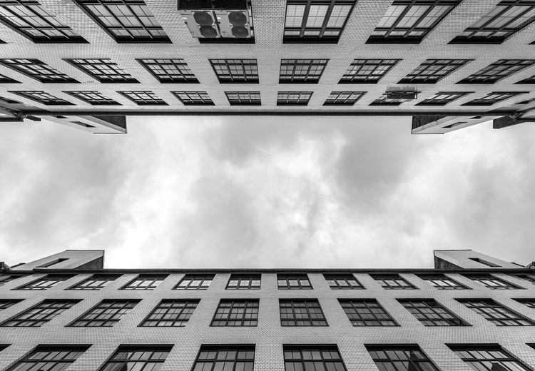 Black And White Parallel Building Exterior Architecture Built Structure Cloud - Sky Sky Building Window Low Angle View No People City Day Residential District Outdoors Nature Apartment Directly Below Tall - High Modern Office Building Exterior Housing Development