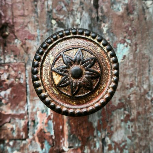 Close-Up Of Floral Pattern On Old Door Handle