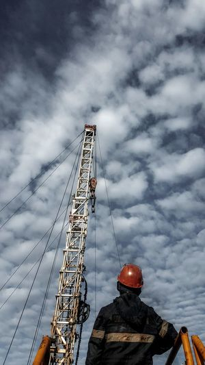 Low angle view of construction crane against sky
