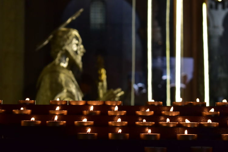 Burning Candle Close-up Day Flame Heat - Temperature Human Representation Illuminated Indoors  No People Religion San Nicola Bari ❤ Sculpture Spirituality Statue The Photojournalist - 2017 EyeEm Awards Premium_collection Premium Collection Premiumposts Premium