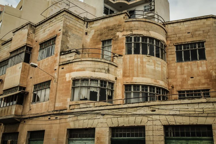 I guess nobody's home... Architecture Architecture Architecture_collection Broken Windows Building Exterior Façade Low Angle View Malta Old Buildings Old House Ruins Sliema The Architect - 2016 EyeEm Awards