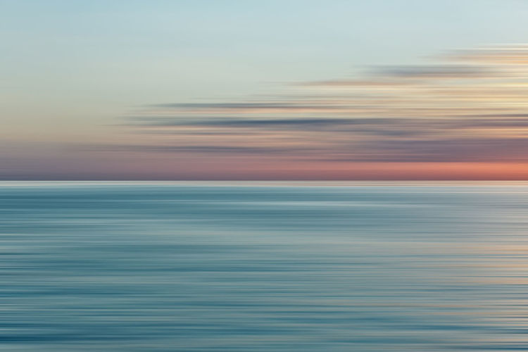 Colorful sunrise with long exposure effect, horizontal motion blurred for background Beach Beauty In Nature Cloud - Sky Day Horizon Over Water Idyllic Nature No People Outdoors Scenics Sea Sky Sunset Tranquil Scene Tranquility Water Waterfront