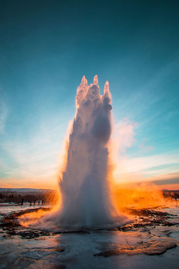 Geyser Strokkur, Golden Circle, Iceland, Europe Geyser Geysir Geysir Hot Springs Geyser Iceland Iceland Strokkur Geysir Strokkur Strokkur Geyser Sky Power In Nature Geology Heat - Temperature Nature Water No People Beauty In Nature Power Outdoors Steam Environment Motion Erupting Orange Color Physical Geography Scenics - Nature Sunset Hot Spring