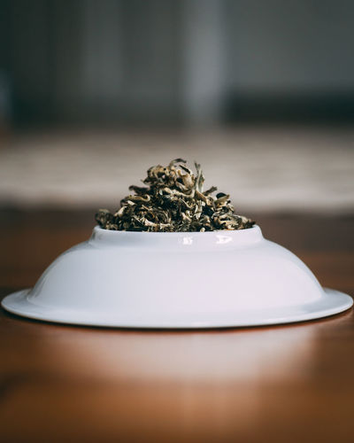 Close-Up Of Tea Leaves In Plate On Table