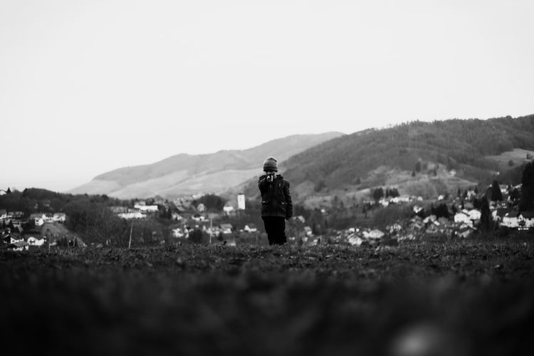 Serious landscape Army Soldier Black & White Black And White Blackandwhite Boy Child Children Clear Sky Dark Day Gun Landscape Mountain Nature One Person Outdoors People Pistol Real People Shadows & Lights Shoot Shooting Story Village Young Welcome To Black Lost In The Landscape