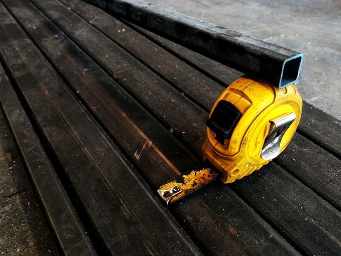 High angle view of old tape measure on table