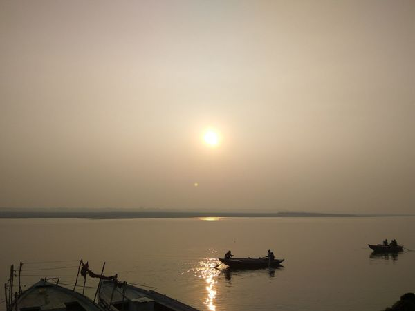 Boats on daily routine along river Ganga near Varanasi #Boats #ganga River #varanasi Horizon Over Water Reflection Scenics Sun Tranquility