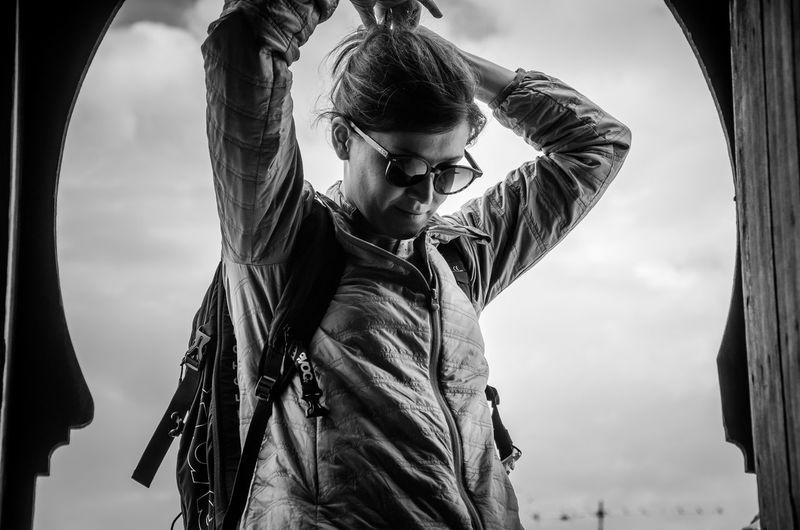 Portrait of man standing against sky
