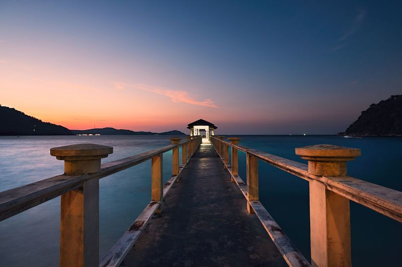 Pier at Perhentian islands during amazing sunset, Malaysia Amazing Place Beauty In Nature Idyllic Island Jetty Moody Sky Nature Nature Night Nightphotography No People Outdoors Pier Sea Seascape Sunrise_sunsets_aroundworld Sunset Tourism Tourist Resort Tranquil Scene Travel Travel Destinations Travel Photography Vacations