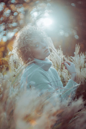 Beautiful Woman Beauty In Nature Childhood Close-up Day Field Grass Growth Happiness Leisure Activity Lifestyles Nature One Person Outdoors People Real People Smiling The Portraitist - 2017 EyeEm Awards Tree Warm Clothing Young Adult Young Women