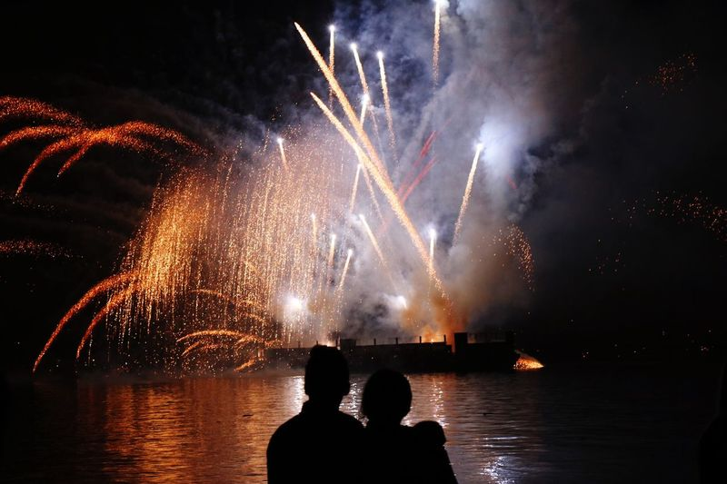 Watching fireworks Night Firework Display Exploding Firework - Man Made Object Glowing Celebration Event Long Exposure Arts Culture And Entertainment Real People Watching Firework Illuminated Motion Water Togetherness Outdoors Two People Men Sky The Week On EyeEm