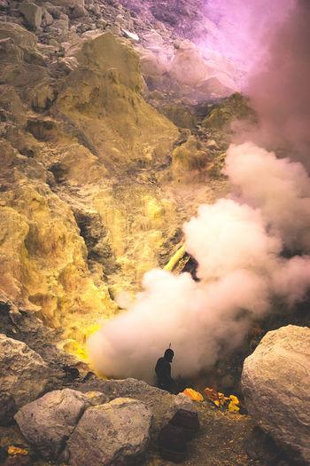 Man Standing On Volcano