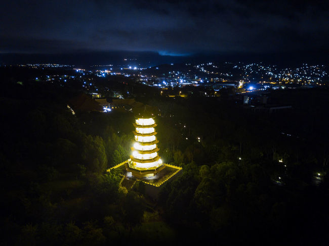 An illuminated pagoda sits atop a mountain overlooking Wollongong. Australia DJI Mavic Pro EyeEmReady Pagoda Aerial Photography Architecture Australian Photographers Building Exterior Built Structure City Cityscape Drone Photography Electricity  Illuminated Mavic Pro Nature Night No People Outdoors Sky Week On Eyeem Wollongong  Mobility In Mega Cities Stories From The City