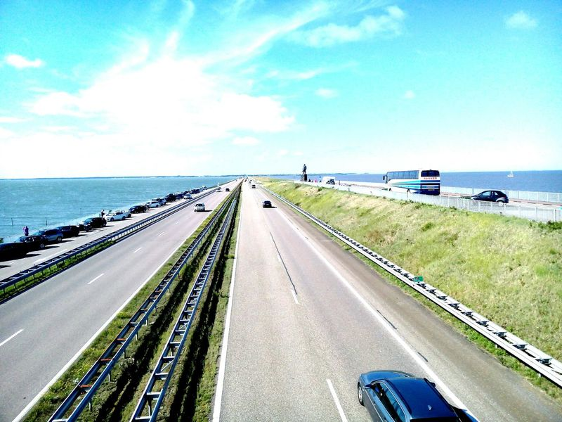 Closure Dike (dutch:Afsluitdijk) running from Den Oever (North Holland) to Zurich (Friesland) Ijsselmeer Zuidersee North Sea Friesland Sky Sea Motorway A7 The Netherlands North Holland