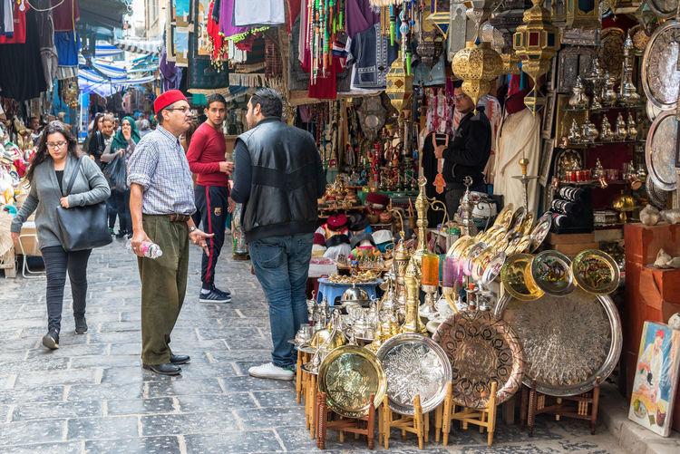 People walking on street in market