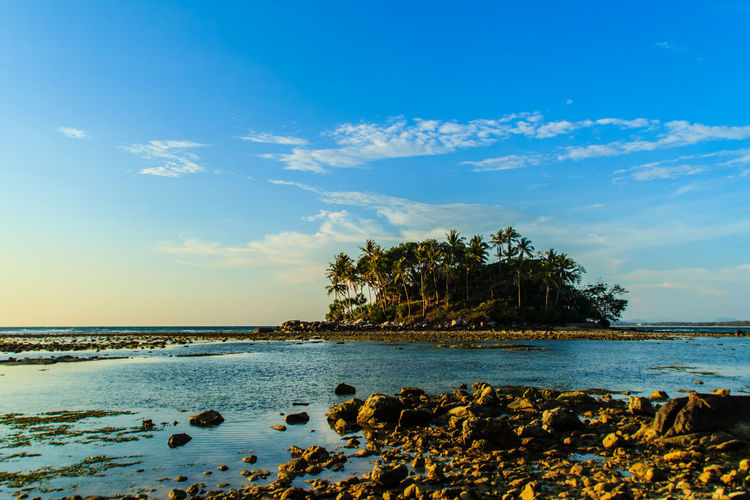 Lonely remote island with rock beach. Beautiful rocky coastline with full of stones on the beach when the sea water receded with dramatic blue sky background on the cloudy day. Coastline Coastline Landscape Coastline Nature Water Lonely Lonely Island Lonely Place  Peaceful View Rock Beach Sea Rocky Beach Rocky Coastline Rocky Shore Beach Beauty In Nature Blue Cloud - Sky Coastline Sky Day Horizon Over Water Lonelyplanet Nature No People Outdoors Peaceful Peaceful Nature Peaceful Place Rock - Object Rock Beach Rocky Coast Rocky Landscape Scenics Sea Sky Tranquil Scene Tranquility Water