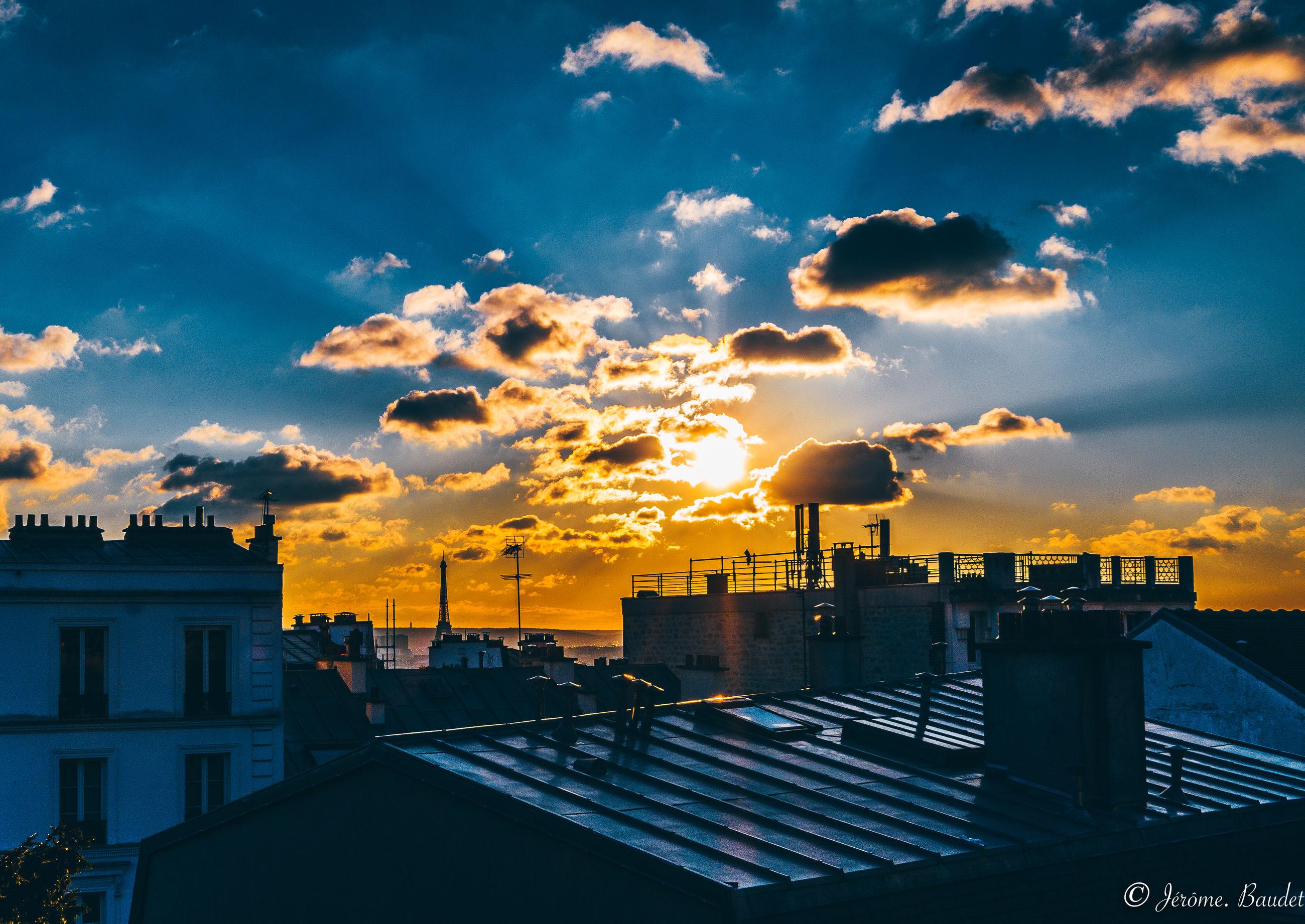 cloud - sky, sky, architecture, building exterior, built structure, sunset, city, building, nature, sunlight, orange color, no people, cityscape, residential district, outdoors, silhouette, sun, sunbeam, urban skyline, beauty in nature, office building exterior, skyscraper