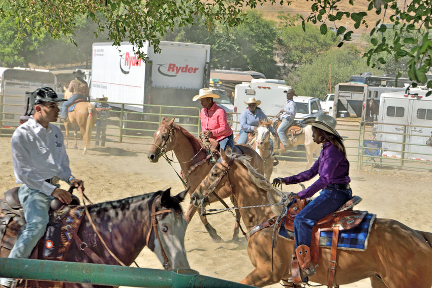 Cowboys & Cowgirls Warmup 2 Bill Pickett Rodeo Rowell Ranch Hayward, Ca. Warmup Horses Bill Pickett Born 1870 Jenks-Branch,Texas Cowboy Rodeo Legend ProRodeo Hall Of Fame Wild West Shows Bill Pickett Invitational Rodeo 33rd Anniversary Exhibition Equestrian Sport National Touring Rodeo Competition Professional Rodeo Cowboys Association Cowboys Cowgirls Corral Fence Horse Trailers Trucks