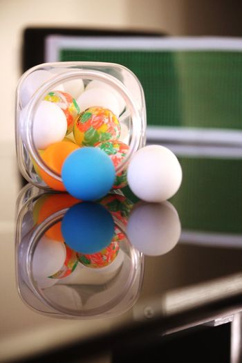 Ways Of Seeing Reflection Game Table Reflection Small White Ball Small Orange Ball Table Tennis Ball Table Tennis Net Multi Colored Indoors  Table Ball No People Still Life Close-up Focus On Foreground Container Summer Sports