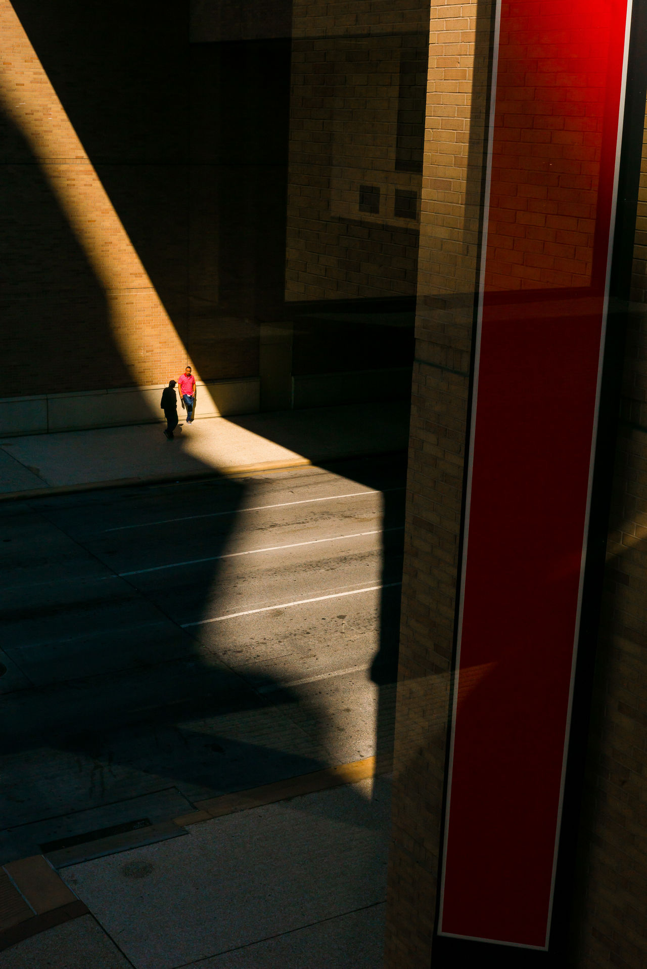 shadow, sunlight, architecture, real people, built structure