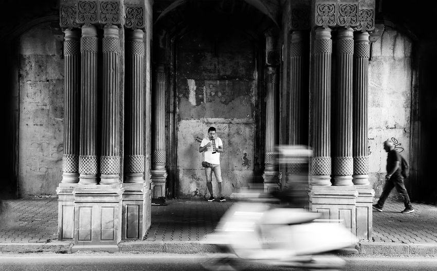 Blurred motion of people walking in historic building