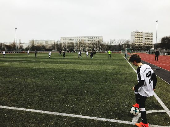 Sport Large Group Of People Real People Sports Clothing Day Playing Outdoors Soccer Sports Uniform Team Sport Competitive Sport Soccer Field Sportsman Soccer Uniform Sports Team Teamwork Grass Men Soccer Player