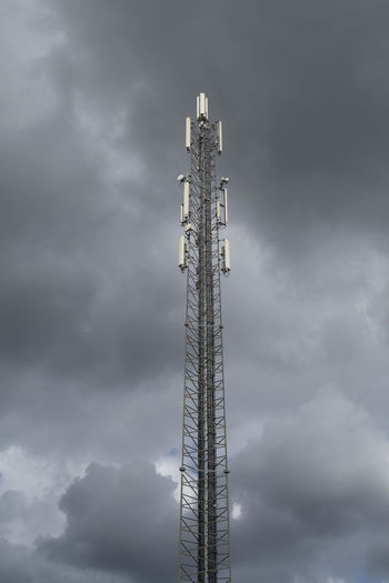 Telecommunication mast for signals for telephone with a clouded threatening sky Telecommunications Telecommunications Equipment Clouded Sky Telephone Mast Mast Tower Cloud - Sky Technology Broadcasting Low Angle View Built Structure Global Communications Connection Outdoors Electrical Equipment