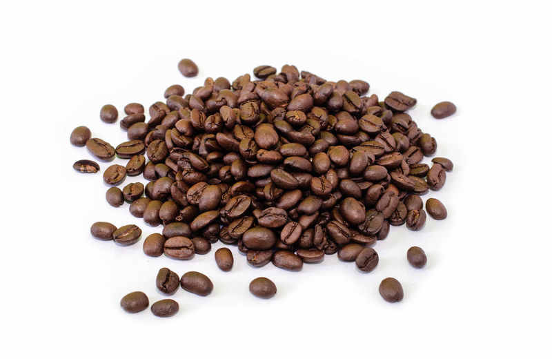 High angle view of coffee beans on white background