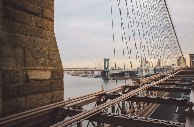 Architecture Architecture Bridge - Man Made Structure Brooklyn Bridge  Brooklyn Bridge / New York Building Exterior Built Structure City City Cityscape Cloud - Sky Connection Day New York New York City No People Outdoors River Sky Sunset Suspension Bridge Transportation Travel Destinations Water Winter