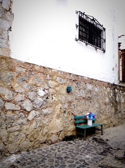 Bench Architecture Building Exterior Residential Structure Stone Wall Wall Outdoors Exterior Rural Scene No People Stone Material Empedrado The Street Photographer - 2017 EyeEm Awards