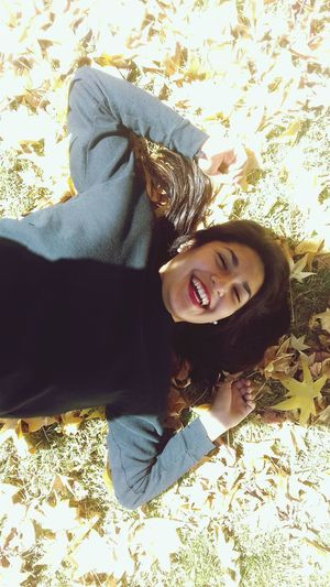 Smiling High Angle View One Person Lying Down Portrait Happiness Only Women Relaxation People One Woman Only Looking At Camera Cheerful One Young Woman Only Adult Adults Only Shadow Sitting Day Young Adult Indoors