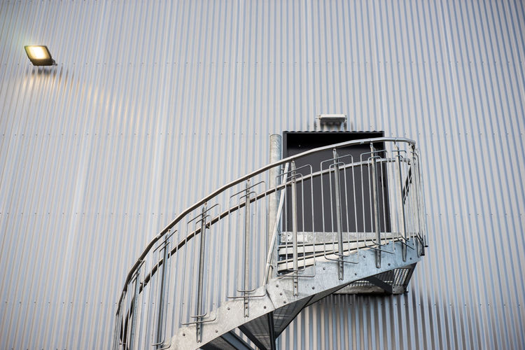 winding stairs Winding Staircase Architecture Building Exterior Built Structure Corrugated Iron Day Door Hand Rail Metal No People Outdoors Railing Staircase Steps Steps And Staircases Winding Stairs The Graphic City The Architect - 2018 EyeEm Awards