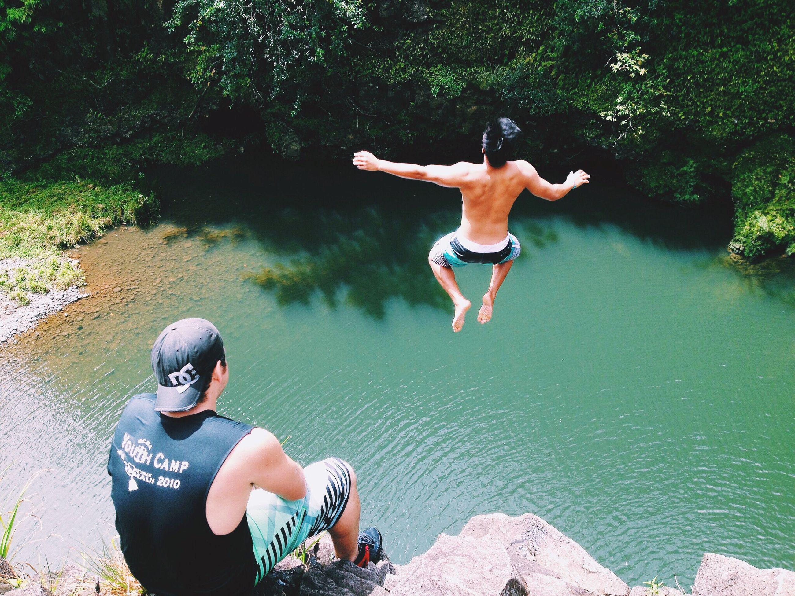 FULL LENGTH OF GIRL JUMPING ON SWIMMING POOL